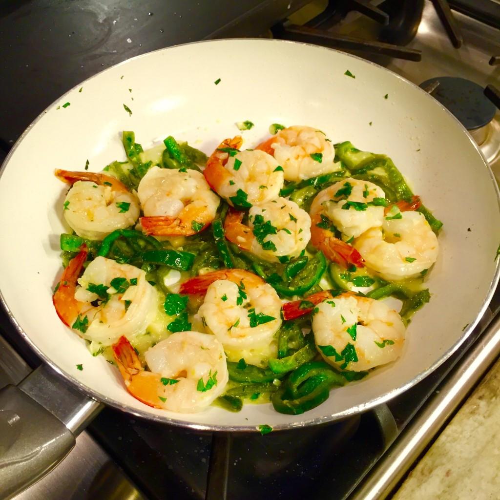 cooking in pan lemon garlic shrimp